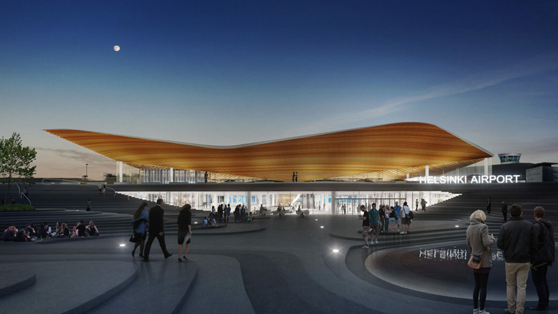 Helsinki-Vantaa airport's expansive, sloping rooftop installed over terminal 2 at night